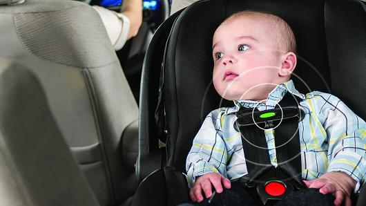 Bebê conforto com alerta de segurança
